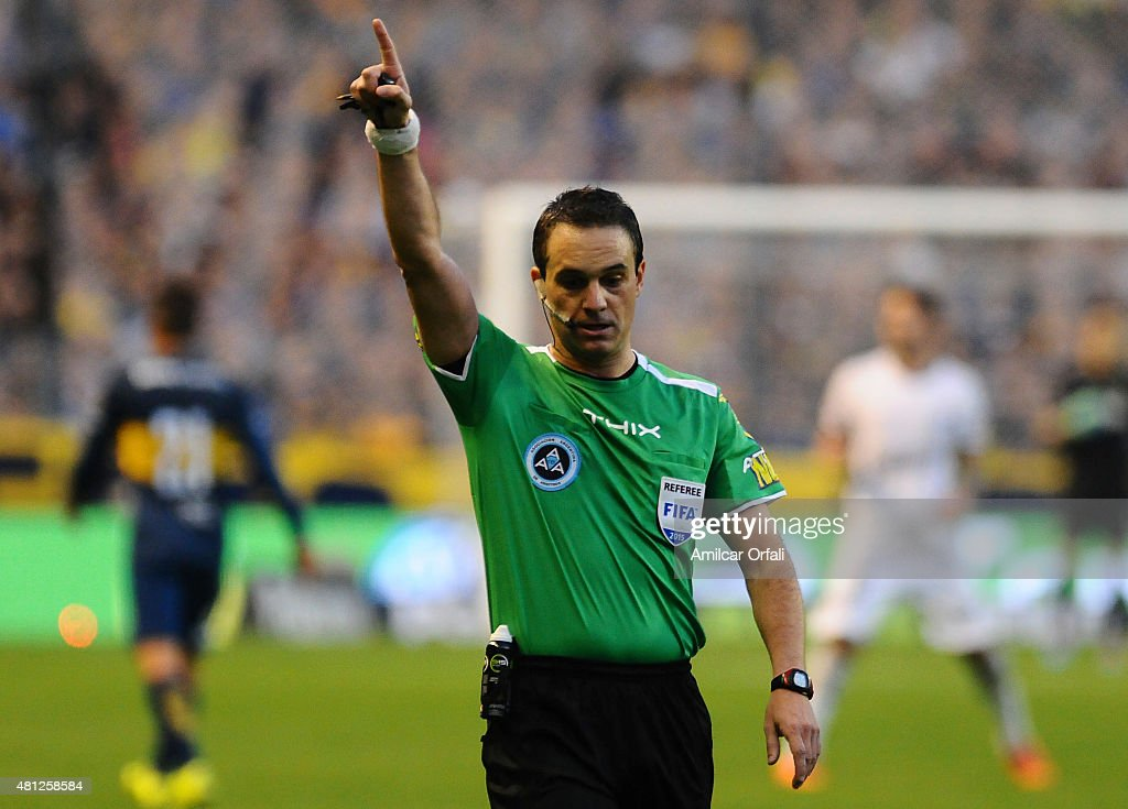 Referee <a gi-track='captionPersonalityLinkClicked' href=/galleries/search?phrase=Patricio+Loustau&family=editorial&specificpeople=7946692 ng-click='$event.stopPropagation()'>Patricio Loustau</a> signals during a match between Boca Juniors and Quilmes as part of 17th round of Torneo Primera Division 2015 at Alberto J Armado Stadium on July 18, 2015 in Buenos Aires, Argentina.