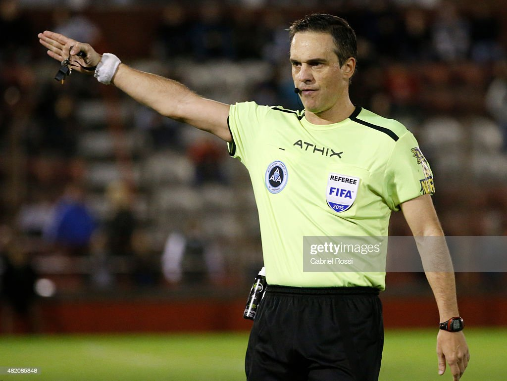 Referee <a gi-track='captionPersonalityLinkClicked' href=/galleries/search?phrase=Patricio+Loustau&family=editorial&specificpeople=7946692 ng-click='$event.stopPropagation()'>Patricio Loustau</a> signals during a match between Huracan and Estudiantes as part of 18th round of Torneo Primera Division 2015 at Tomas Adolfo Duco Stadium on July 26, 2015 in Buenos Aires, Argentina.