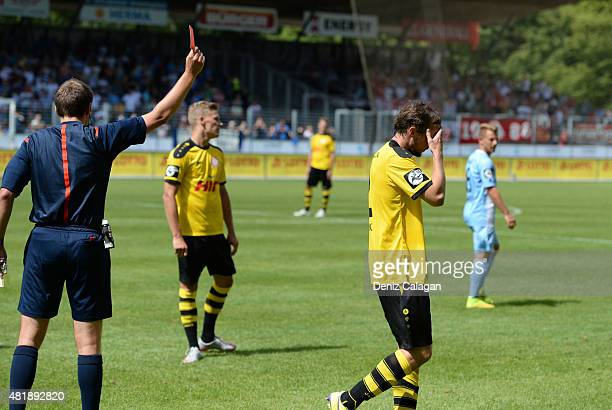 Referee Patrick Alt shows Tobias Fink of Fortuna Koeln the red card during the 3 Liga match between Stuttgarter Kickers and Fortuna Koeln at...