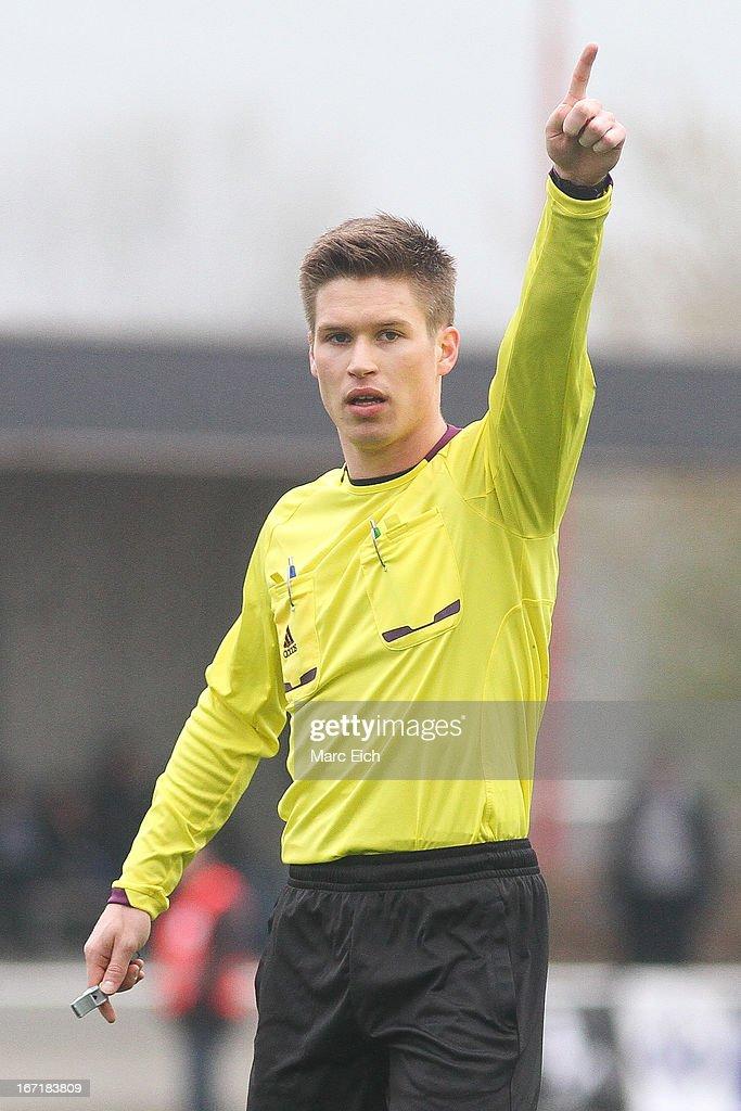Referee Patrick Hanslbauer gestures during the Regionalliga Bayern match between FV Illertissen and 1860 Muenchen II at Voehlinstadion on April 20, 2013 in Illertissen, Germany.
