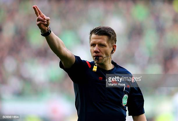 Referee Patrick Ittrich makes a point during the Bundesliga match between VfL Wolfsburg and FC Ingolstadt at Volkswagen Arena on February 13 2016 in...