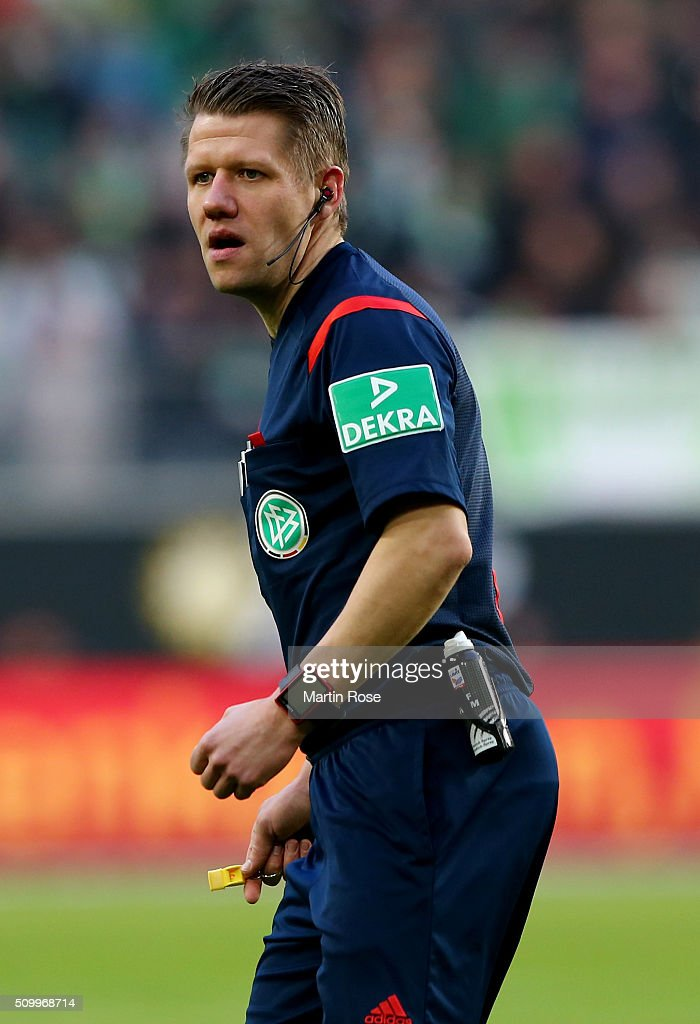 Referee Patrick Ittrich makes a point during the Bundesliga match between VfL Wolfsburg and FC Ingolstadt at Volkswagen Arena on February 13, 2016 in Wolfsburg, Germany.