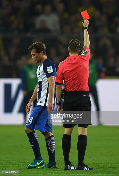 Referee Patrick Ittrich shows the red card to Hertha's Swiss midfielder Valentin Stocker during the German first division Bundesliga football match...