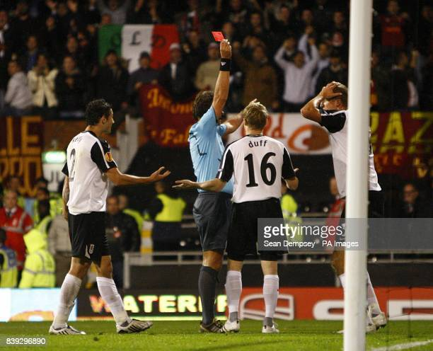 Referee Paul Allaerts wrongly shows Fulham's Brede Hangeland the red card on the advice of his assistant after Stephen Kelly fouls AS Roma's John...