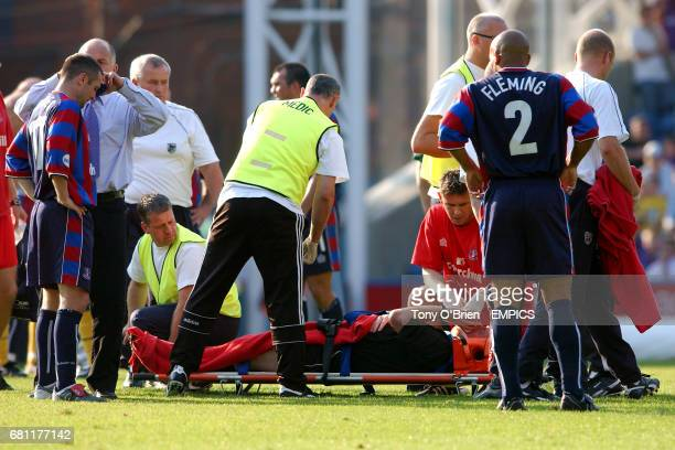 Referee Paul Danson is put on a stretcher after he is knockeed out in a collison with Crystal Palace's Michael Hughes