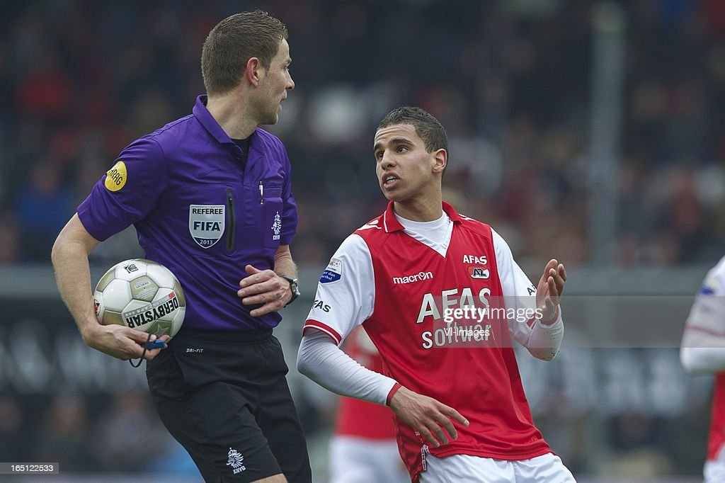 referee Paul van Boekel, Adam Maher of AZ during the Dutch Eredivisie match between Heracles Almelo and AZ Alkmaar at the Polman Stadium on march 31, 2013 in Almelo, The Netherlands