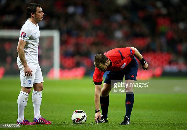 Referee Pavel Kralovec of the Czech Republic marks the spot of an England free kick during the EURO 2016 Qualifier match between England and...