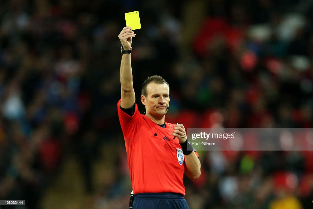 Referee Pavel Kralovec of the Czech Republic shows the yellow card during the EURO 2016 Qualifier match between England and Lithuania at Wembley...