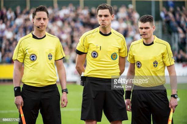 Referee Per Rehnlund Magnus Lindgren and Tobias Warn during the Allsvenskan match between IK Sirius FK and Hammarby IF at Studenternas IP on May 21...