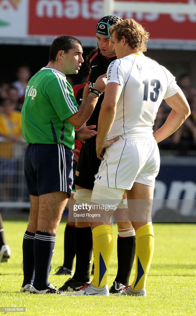 Referee Peter Allan of Scotland, issues a warning to captains <a gi-track='captionPersonalityLinkClicked' href=/galleries/search?phrase=Steve+Borthwick&family=editorial&specificpeople=204426 ng-click='$event.stopPropagation()'>Steve Borthwick</a> of Saracens and <a gi-track='captionPersonalityLinkClicked' href=/galleries/search?phrase=Aurelien+Rougerie&family=editorial&specificpeople=220239 ng-click='$event.stopPropagation()'>Aurelien Rougerie</a> (R) during the Heineken Cup match between ASM Clermont Auvergne and Saracens at Stade Marcel Michelin on October 9, 2010 in Clermont Ferrand, France.