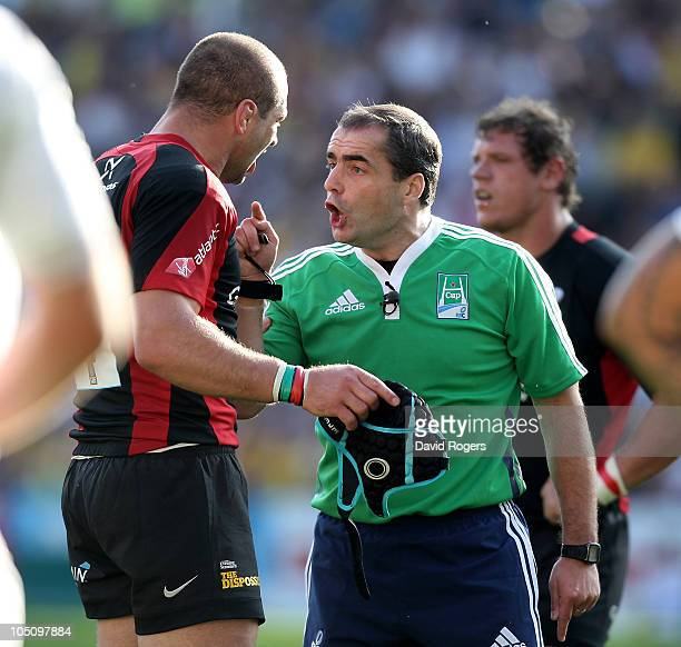 Referee Peter Allan of Scotland issues a warning to Saracens captain Steve Borthwick during the Heineken Cup match between ASM Clermont Auvergne and...
