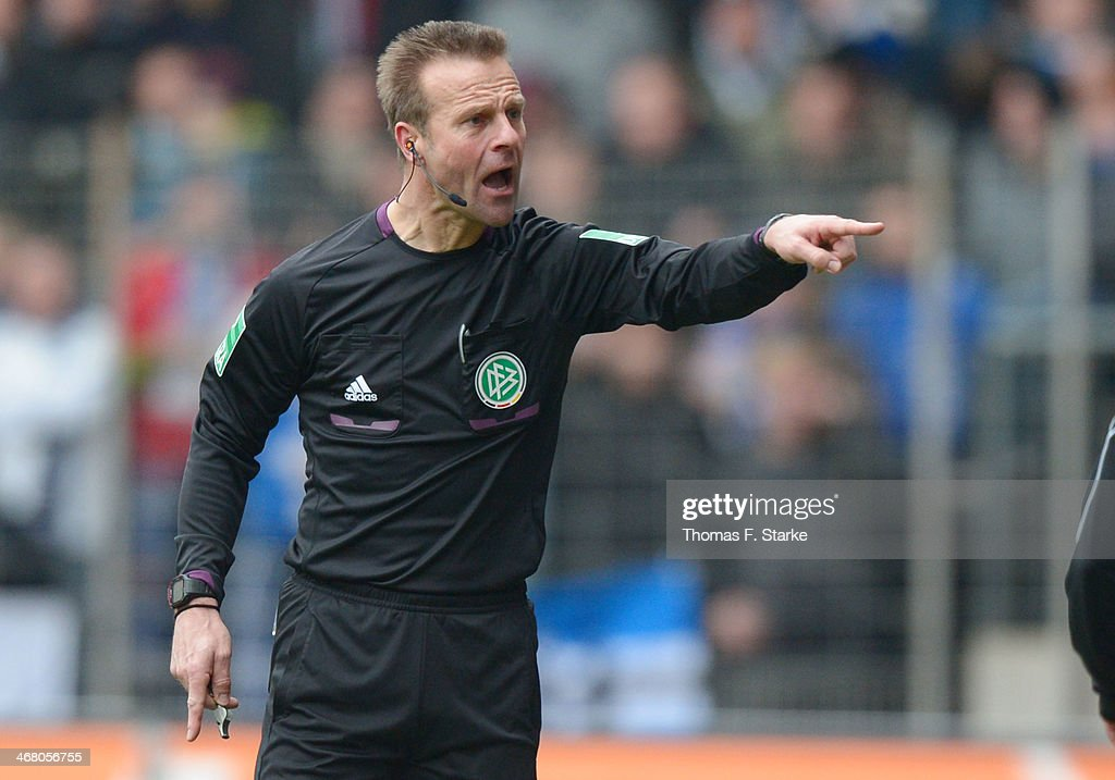 Referee Peter Gagelman reacts during the Second Bundesliga match between Arminia Bielefeld and FC St. Pauli at Schueco Arena on February 9, 2014 in Bielefeld, Germany.