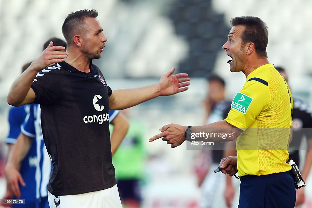 Referee <a gi-track='captionPersonalityLinkClicked' href=/galleries/search?phrase=Peter+Gagelmann&family=editorial&specificpeople=808542 ng-click='$event.stopPropagation()'>Peter Gagelmann</a> discusses with John Verhoek of St. Pauli during the Second Bundesliga match between Karlsruher SC and FC St. Pauli at Wildpark Stadium on April 10, 2015 in Karlsruhe, Germany.