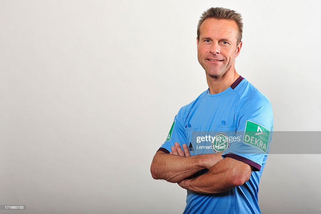 Referee <a gi-track='captionPersonalityLinkClicked' href=/galleries/search?phrase=Peter+Gagelmann&family=editorial&specificpeople=808542 ng-click='$event.stopPropagation()'>Peter Gagelmann</a> poses during the DFB referee team presentation on June 27, 2013 in Grassau, Germany.