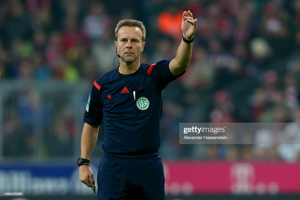 Referee <a gi-track='captionPersonalityLinkClicked' href=/galleries/search?phrase=Peter+Gagelmann&family=editorial&specificpeople=808542 ng-click='$event.stopPropagation()'>Peter Gagelmann</a> reacts during the Bundesliga match between FC Bayern Muenchen and 1899 Hoffenheim at Allianz Arena on November 22, 2014 in Munich, Germany.