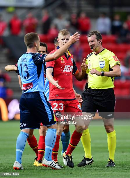 Referee Peter Green gives Brandon O'Neill of Sydney FC a yellow card during the round nine ALeague match between the Adelaide 36ers and the Sydney...