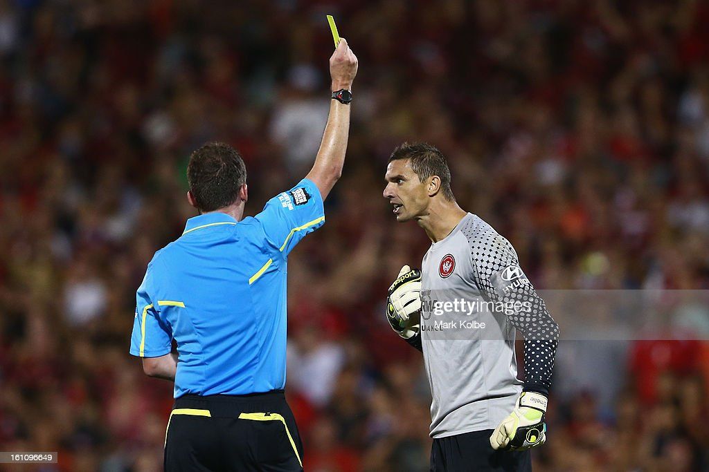 Referee Peter Green shows a yelow card to Ante Covic of the Wanderers for wasting time during the round 20 A-League match between the Western Sydney Wanderers and the Newcastle Jets at Campbelltown Sports Stadium on February 9, 2013 in Sydney, Australia.
