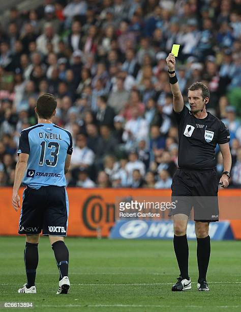 Referee Peter Green shows the yellow card to Brandon O'Neill of Sydney FC during the FFA Cup Final match between Melbourne City FC and Sydney FC at...