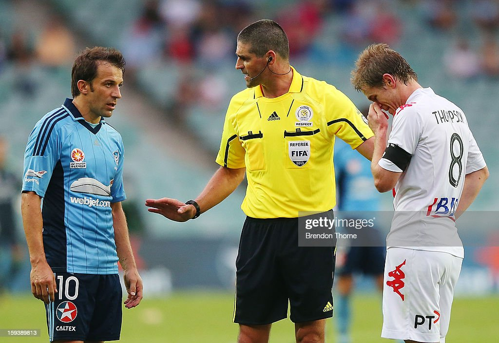 Referee, Peter O'Leary seperates <a gi-track='captionPersonalityLinkClicked' href=/galleries/search?phrase=Alessandro+Del+Piero&family=editorial&specificpeople=206226 ng-click='$event.stopPropagation()'>Alessandro Del Piero</a> of Sydney and Matt Thompson of the Heart after an altercation during the round 16 A-League match between Sydney FC and the Melbourne Heart at Allianz Stadium on January 13, 2013 in Sydney, Australia.