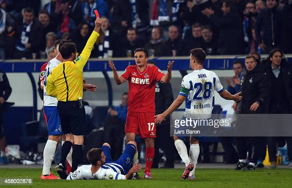 Referee Peter Sippel shows Slawomir Peszko of Koeln the red card during the DFB Cup second round match between MSV Duisburg and 1 FC Koeln at...