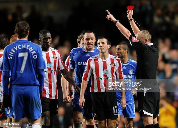 Referee Peter Walton shows Sunderland's Liam Miller the red card