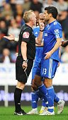 Referee Peter Walton talks with Michael Ballack of Chelsea after a Branislav Ivanovic disallowed goal during the Barclays Premier League match...