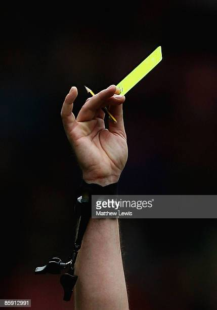 Referee Phil Dowd awards a yellow card to Andrew Taylor of Middlesbrough during the Barclays Premier League match between Middlesbrough and Hull City...