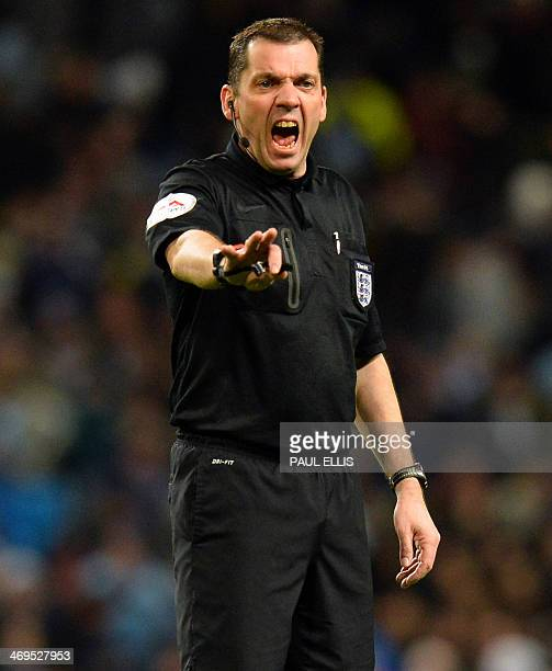 Referee Phil Dowd gestures during the English FA Cup fifth round football match between Manchester City and Chelsea at The Etihad Stadium in...