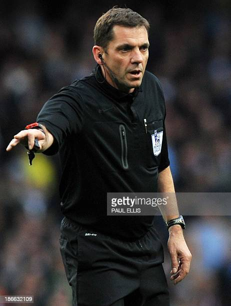 Referee Phil Dowd gestures during the English Premier League football match between Manchester City and Norwich City at the Etihad Stadium in...