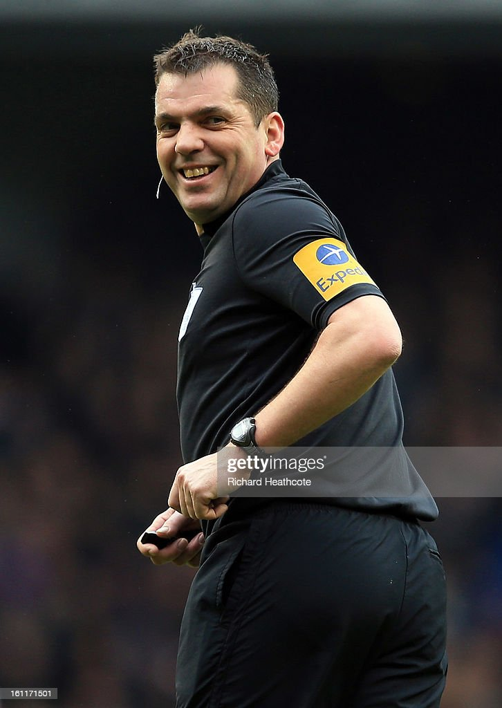Referee Phil Dowd in action during the Barclay's Premier League match between Tottenham Hotspur and Newcastle United at White Hart Lane on February 9, 2013 in London, England.