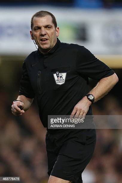 Referee Phil Dowd officiates the English Premier League football match between Chelsea and Manchester United at Stamford Bridge in London on January...