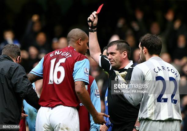 Referee Phil Dowd shows Aston Villa's Zat Knight the red card for a professional foul on Chelsea's Michael Ballack