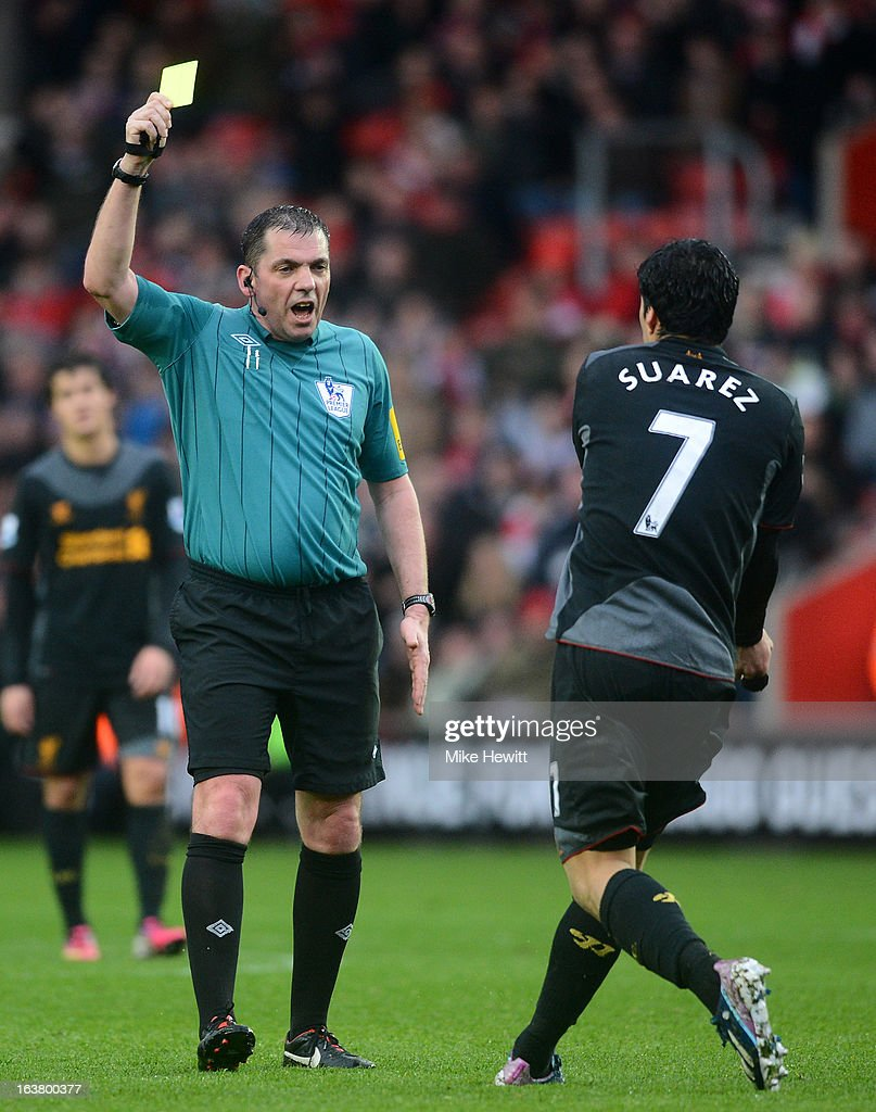 Referee Phil Dowd shoWs Luis Suarez of Liverpool during the Barclays Premier League match between Southampton and Liverpool at St Mary's Stadium on March 16, 2013 in Southampton, England.