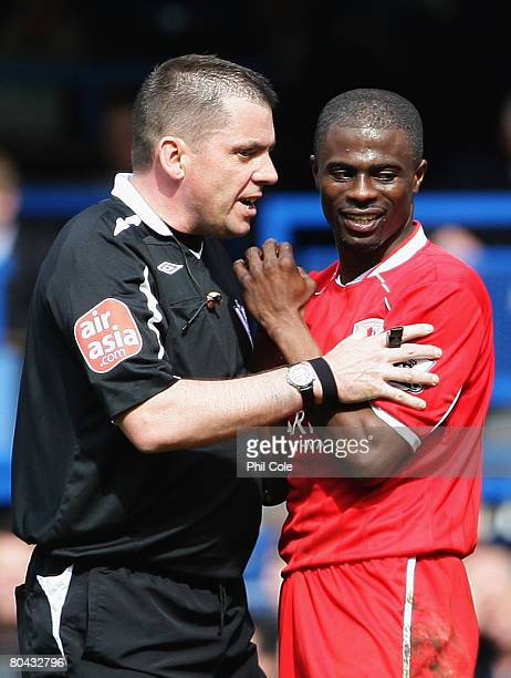 Referee Phil Dowd talks to George Boateng of Middlesbrough during the Barclays Premier League match between Chelsea and Middlesbrough at Stamford...