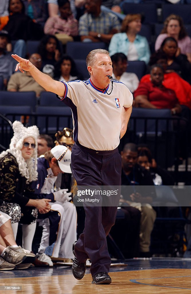 Referee Phil Robinson makes a call during the NBA game between the New Jersey Nets and the Memphis Grizzlies at the FedExForum on March 12 2007 in...