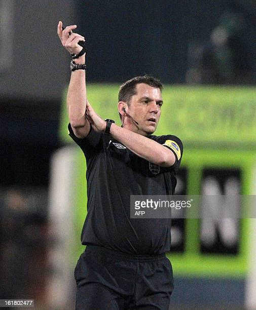 Referee Philip Dowd signals a hand ball during the fifth round FA Cup football match between Oldham Athletic and Everton at Boundary Park in Oldham...