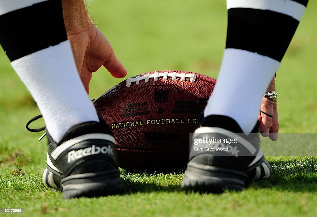 A referee picks up a ball during the game between the St Louis Rams and the Jacksonville Jaguars at Jacksonville Municipal Stadium on October 18 2009...