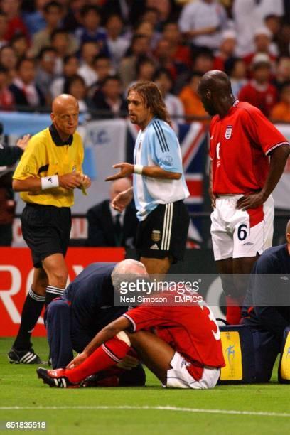 Referee Pierluigi Collina prepares to book Argentina's Gabriel Batistuta for a foul on England's Ashley Cole