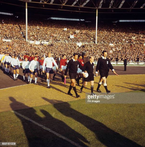 Referee Pierre Schwinte leads the teams out at Wembley followed by England's Bobby Moore George Cohen Alan Ball Roger Hunt Ray Wilson Geoff Hurst...