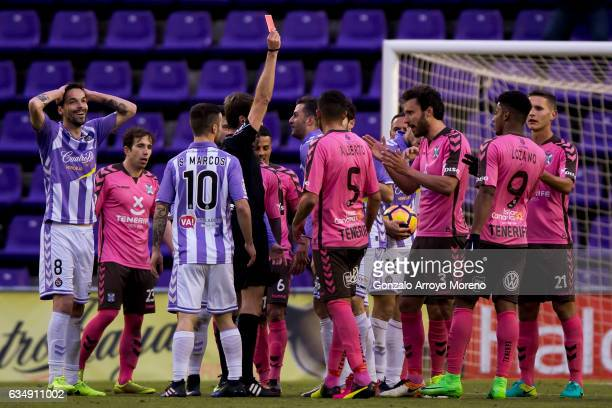 Referee Pizarro Gomez shows the red card to Juan Villar of Real Valladolid CF during the La Liga second league match between Real Valladolid CF and...