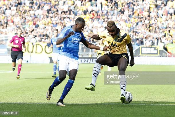 referee Pol van Boekel Derrick Luckassen of PSV Thierry Ambrose of NAC Breda during the Dutch Eredivisie match between NAC Breda and PSV Eindhoven at...