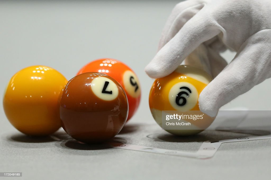 A referee racks the balls ahead of play in the Billiards, Men's 9 Ball Single Quarterfinals matches at Songdo Convensia on day three of the 4th Asian Indoor & Martial Arts Games on July 1, 2013 in Incheon, South Korea.