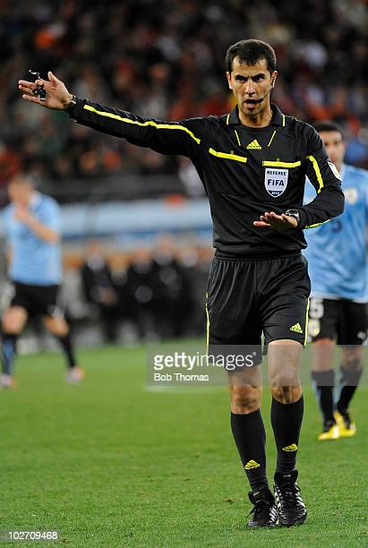 Referee Ravshan Irmatov during the 2010 FIFA World Cup South Africa Semi Final match between Uruguay and the Netherlands at Green Point Stadium on...