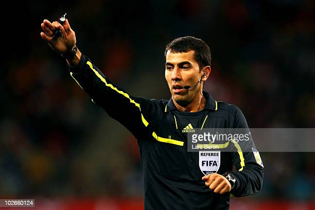 Referee Ravshan Irmatov gestures as he makes a decision during the 2010 FIFA World Cup South Africa Semi Final match between Uruguay and the...