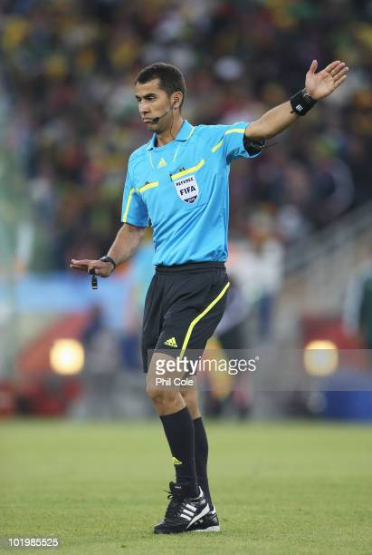 Referee Ravshan Irmatov gestures during the 2010 FIFA World Cup South Africa Group A match between South Africa and Mexico at Soccer City Stadium on...