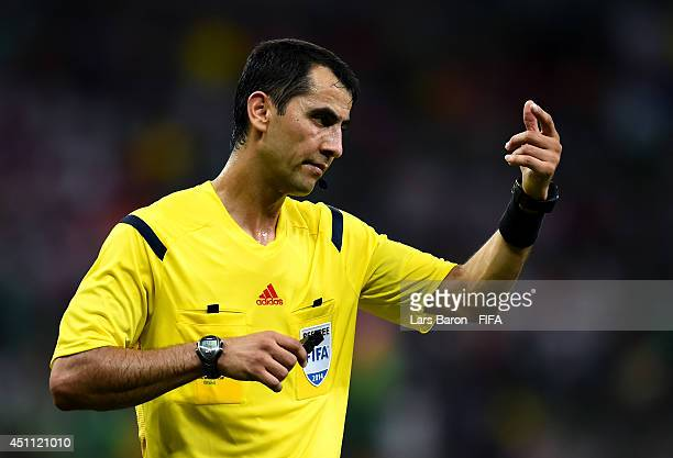 Referee Ravshan Irmatov gestures during the 2014 FIFA World Cup Brazil Group A match between Croatia and Mexico at Arena Pernambuco on June 23 2014...