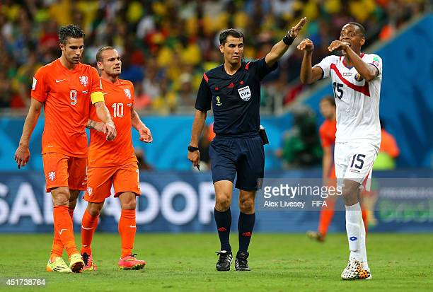 Referee Ravshan Irmatov gestures during the 2014 FIFA World Cup Brazil Quarter Final match between Netherlands and Costa Rica at Arena Fonte Nova on...