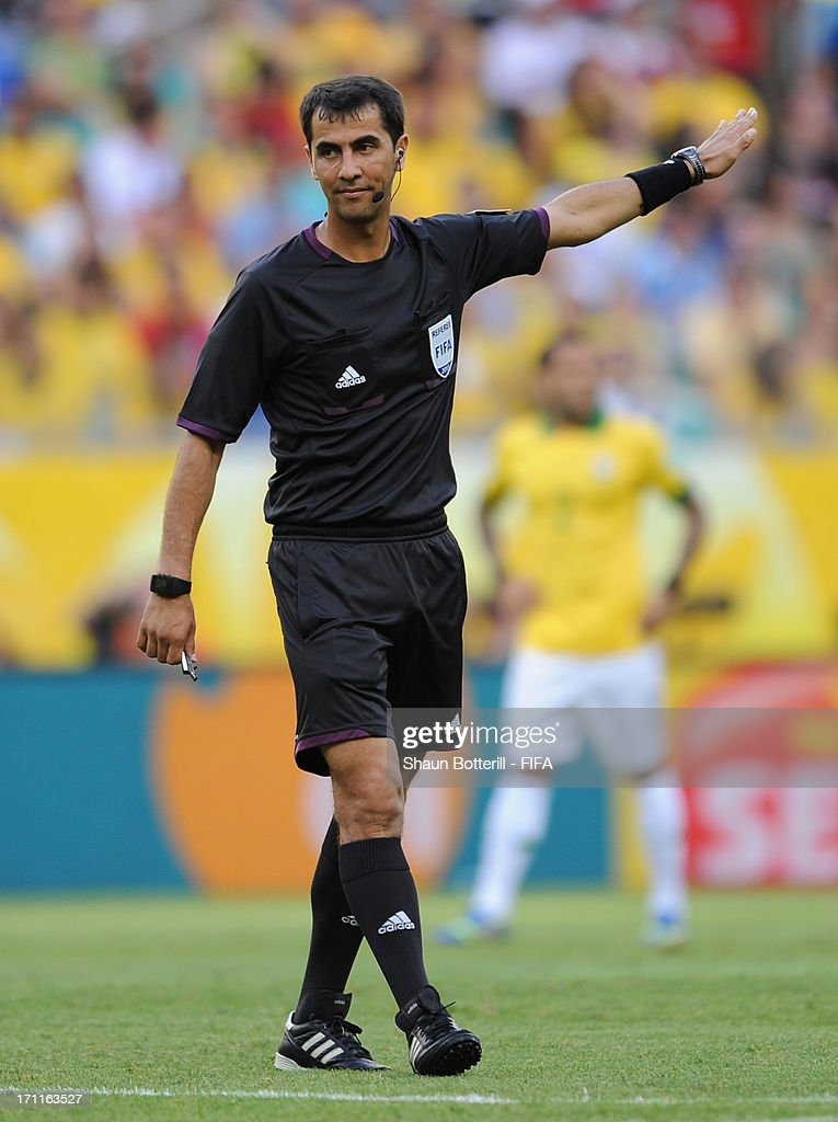 Referee Ravshan Irmatov gestures during the FIFA Confederations Cup Brazil 2013 Group A match between Italy and Brazil at Estadio Octavio Mangabeira (Arena Fonte Nova Salvador) on June 22, 2013 in Salvador, Brazil.