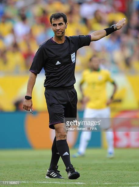 Referee Ravshan Irmatov gestures during the FIFA Confederations Cup Brazil 2013 Group A match between Italy and Brazil at Estadio Octavio Mangabeira...