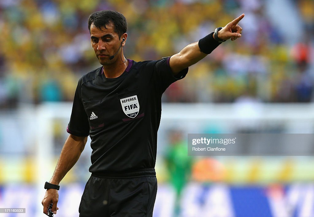 Referee Ravshan Irmatov gestures during the FIFA Confederations Cup Brazil 2013 Group A match between Italy and Brazil at Estadio Octavio Mangabeira (Arena Fonte Nova Salvador) on June 22, 2013 in Salvador, Brazil.